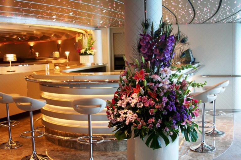 pink and purple flower arrangement for cruise charter